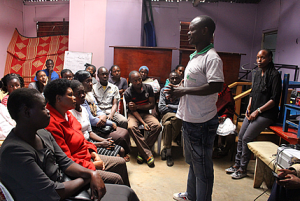 AMWIK's Program Officer Benard Ogoi facilitates a forum at Kibera's NFSS