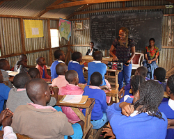 Esther Njogu, a social worker at Kibera's Nairobi Family Support Services (NFSS) takes pupils through a radio listening session.